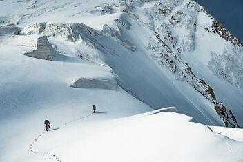 Nicolas Hojac and Lukas Hinterberger run through deep snow on the Xuelian Feng West mountain in China.